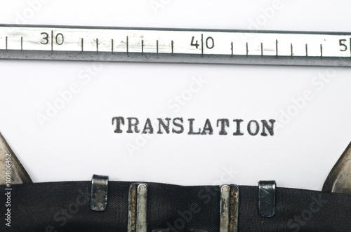 Fotografía  Palabra de traducción escrito en máquina de escribir vieja