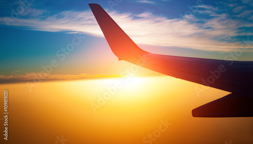 View of the clouds and airplane wing from the Inside Canvas Print