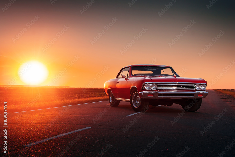 Fototapety, obrazy: Retro red car standing on asphalt road at sunset