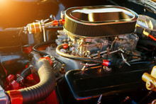 Car Engine Under Hood At Sunset