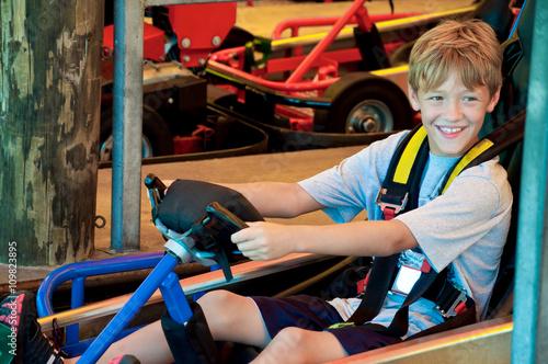 Fotografie, Obraz  Happy cute little boy on go cart.
