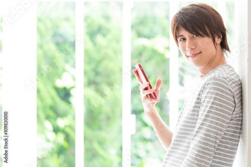 Fotografie, Obraz  portrait of asian man using smart phone