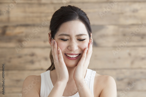 Fotografia, Obraz  Young woman with closed eyes against hand on the cheek