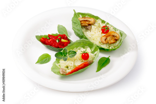 Spoed Fotobehang Voorgerecht Boiled rice (risotto) served into basil leaves