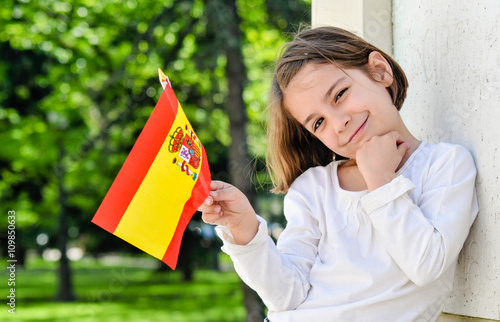 Cheerful Young Girl With Spanish Flag