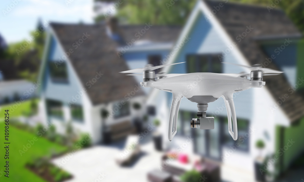 Fototapeta Drone quad copter with camera spying on the house and yard.