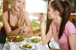 Two Female Friends Enjoying Breakfast At Home Together