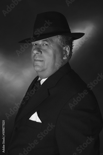Retro 1930s gangster wearing hat. Classic black adn white portra ... 41c26c9ac3a
