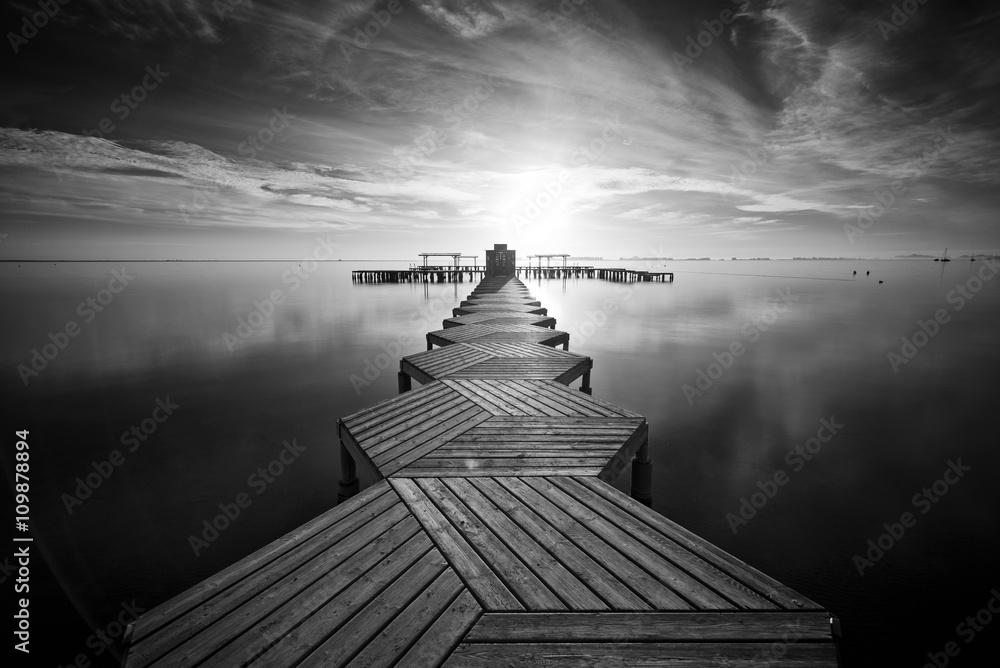 Fototapeta Zig Zag dock at sunrise in Santiago de La Ribera, Mar Menor, Murcia