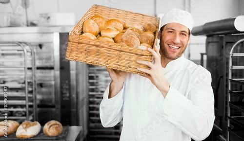 Baker holding basket of bread Fototapete