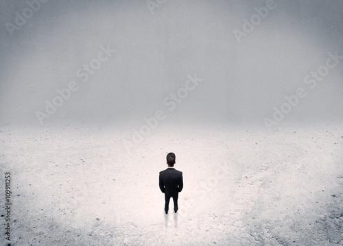 Businessman standing in urban empty space