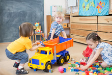 Two Kids Conflict Or Struggling For Toy Truck In Kindergarten