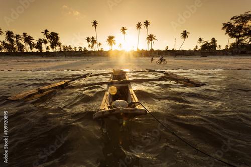 Poster Zanzibar Traditional fishing boat floating on ocean at beautiful sunset i