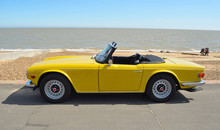 Classic Yellow Triumph TR6 On The Seafront At Felixstowe.
