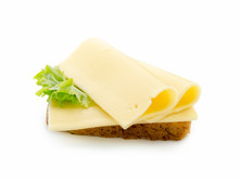 Slices Of Cheese On Bread Toas...