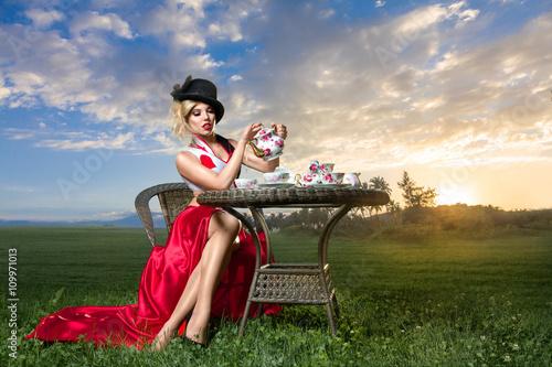 Photo  Woman at wonderland tea-party
