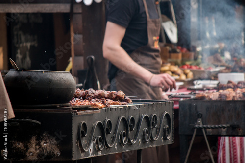 Photo Stands Grill / Barbecue barbeсue grill, skewers with meat, brazier, cauldron, chef