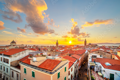 A sunset over Alghero city, Sardinia Wallpaper Mural