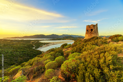 Photo  Susnet over old tower with a panoramic view of Villasimius, Sardinia