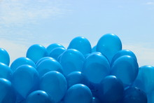 Blue Balloons On The Sky Background