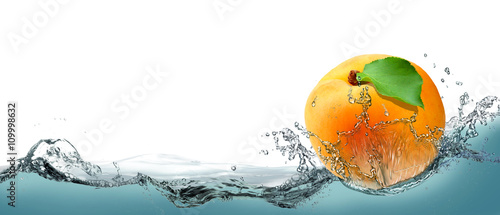 Yellow, juicy apricot as the card on water background. Wallpaper Mural
