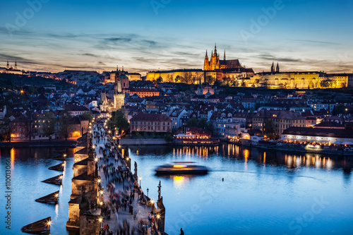 Poster Prague Charles Bridge on Vltava river in Prague, Czech Republic at late sunset, night. Prague Castle