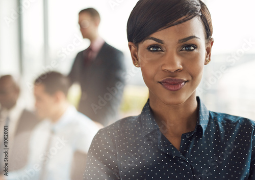 Cuadros en Lienzo Confident business woman in office with group