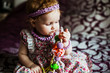 Picture of beautiful little princess baby girl with accessories over white