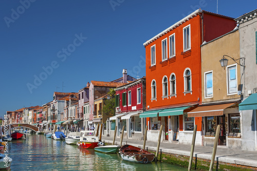 Murano island canal, colorful houses and boats, Venice, Italy. Wallpaper Mural