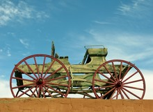 Wooden Waggon On The Roof Against Blue Sky