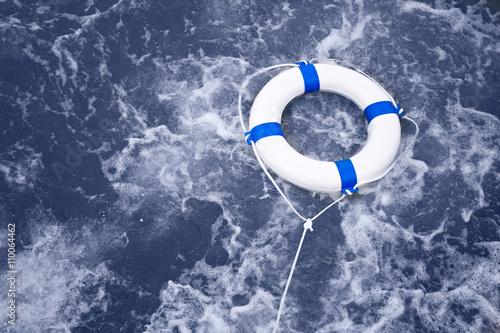 Wallpaper Mural Lifebuoy, lifebelt, life saver rescue in a ocean storm full of f