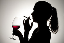 Image Of A Female With Cigarette And Wineglass.