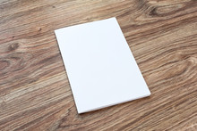 Blank Of Brochure Is On A Wood...