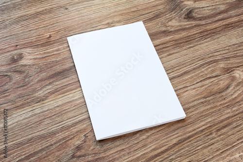 Fotografie, Obraz  Blank of brochure is on a wooden desk.