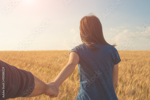 Photo  Young Woman Holding Man's Hand against Landscape