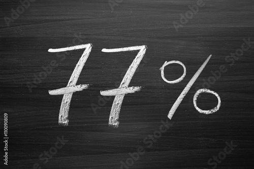 Fotografie, Obraz  77 percent header written with a chalk on the blackboard