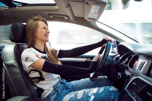 Beautiful blonde woman beep in the car in panic with closed eyes while driving on high speed Canvas Print