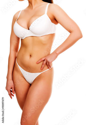 Fototapeta Woman with nice shapes, isolated on white background obraz na płótnie