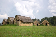 Neolithic Mud, Dirt House Village With Thatched Roof On Spring M