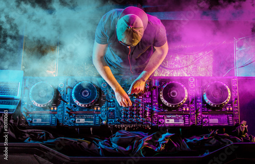 Charismatic disc jockey at the turntable Canvas Print