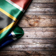 canvas print picture - Flag of South Africa on wooden boards