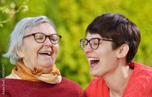 Fotografia  Grandmother and granddaughter. Young woman carefully takes care