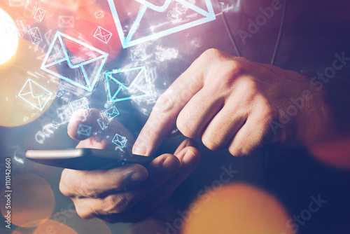 Man sending e-mail message using smartphone Fototapeta