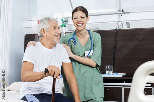 1954a04b36d Female Nurse Standing By Senior Patient In Rehab Center. By Tyler Olson