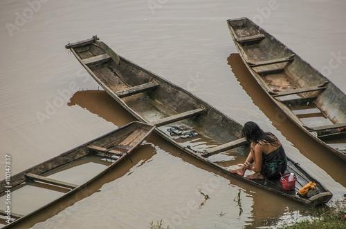 Laos, woman bathing in Mekong river