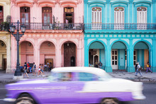 Classic Vintage Car And Colorful Colonial Buildings In The Main Street Of Old Havana, Cuba