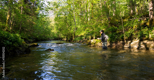 Printed kitchen splashbacks Fishing Fly fisherman fishing trouts in river
