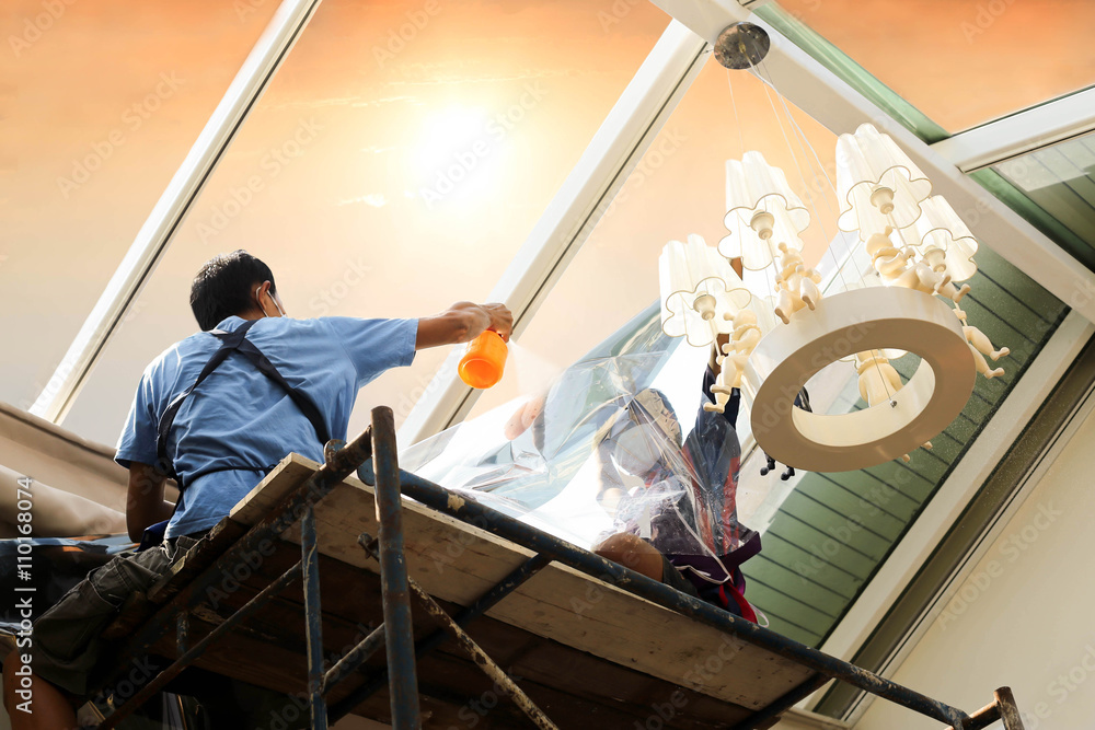 Fototapety, obrazy: unidentified  people wrappers tinting a glass house window
