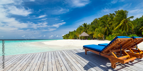 sun lounger bed on jetty in front of paradise island and beach / Sonnenliege auf Poster
