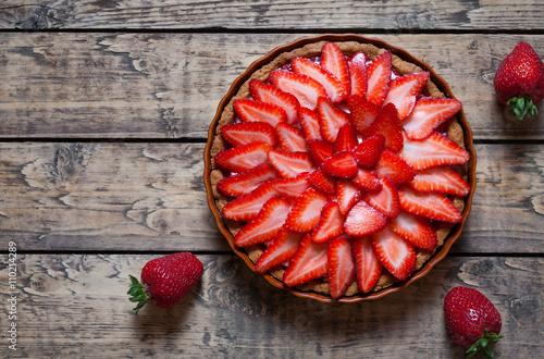 Obraz na płótnie Strawberry tart with cream traditional summer sweet pastry fruit dessert on vint